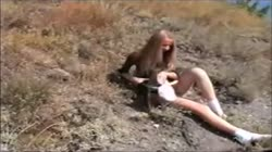 Blonde teen strips and fingers in the woods