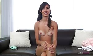 hot tanned lady is touching her small g-spot with enjoyment