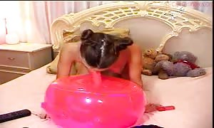 charming black-haired shoves a pink fake penis in her small beaver