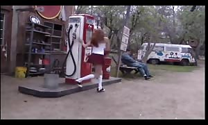 red haired schoolgirl penetrated on a bench outdoors